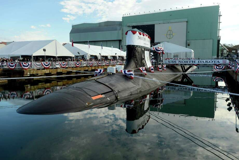 This photo shows an attack submarine named North Dakota before the christening ceremony at the Groton shipyard of sub builder Electric Boat in Groton, Conn., Saturday, Nov. 2, 2013. It is the first Navy vessel to carry the name North Dakota in nearly a century.  (AP Photo/The Day, Dana Jensen) Photo: Dana Jensen, AP / The Day