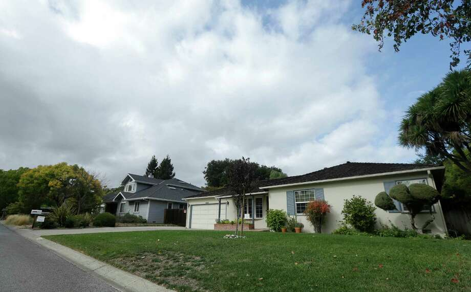 This photo shows 2066 Crist Drive, at right, the home where Steve Jobs grew up, in Los Altos, Calif., Tuesday, Oct. 29, 2013. The Silicon Valley home where Apple co-founder Steve Jobs grew up and built some of his first computers is now on the city's list of historic properties. The historical commission in the city of Los Altos voted unanimously for the historic designation on Monday night, the Palo Alto Daily News reported. Photo: Jeff Chiu, AP / AP2013