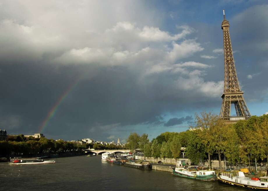 A view of the Eiffel tower along the Seine River in Paris with a Rainbow in Paris on Tuesday Oct. 29 2013. Photo: Jacques Brinon, AP / AP