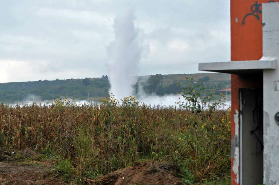 A geyser of gasoline spews from a state-owned pipeline at a field in Tlajomulco, Mexico, Wednesday, Oct. 30, 2013. Authorities were forced to evacuate thousands of residents living near the pipeline after the large gasoline leak. Officials blamed the accident on fuel thieves. The gasoline did not catch fire and there were no immediate reports of injuries. Photo: Uncredited, AP / ALL RIGHTS RESERVED.2013