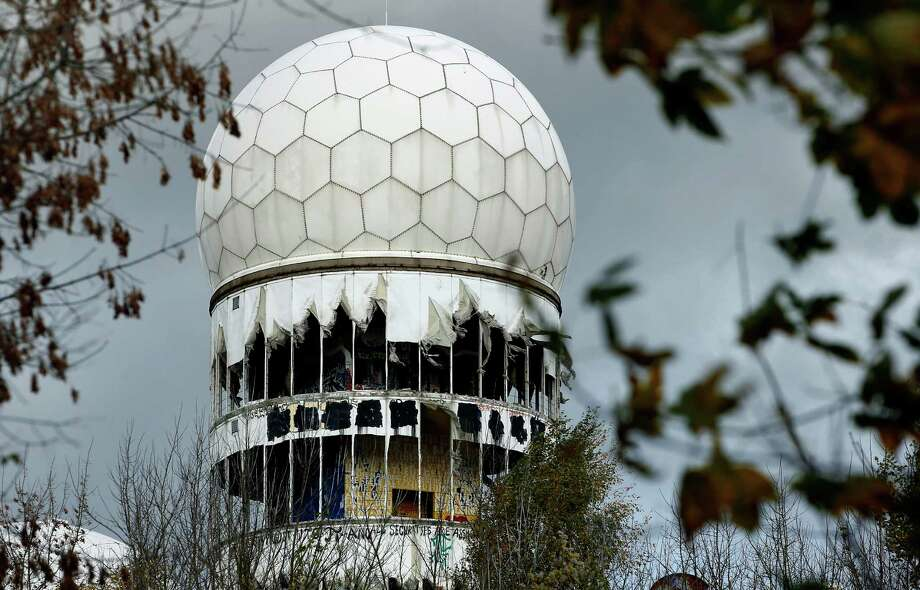 The cover of a former National Security Agency (NSA) radar tower on top of the Teufelsberg (devil mountain) is ripped in Berlin, Germany, Tuesday, Oct. 29, 2013. The mountain, host of listening devices of the US intelligence agencies during the cold war, was build with the debris of buildings that were destroyed during the second world war. Photo: Michael Sohn, AP / AP