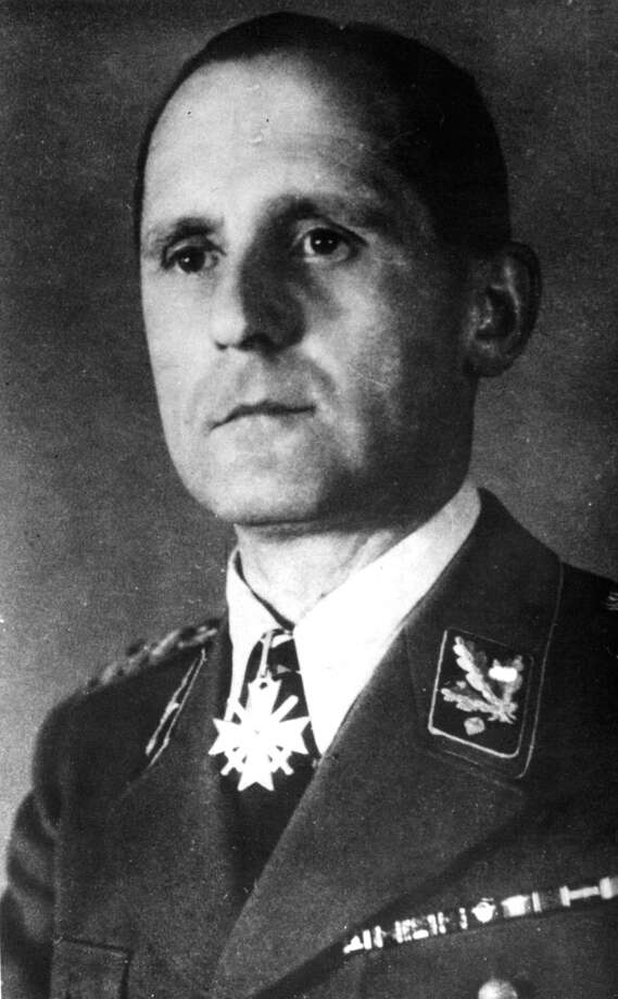 "FILE  - Undated b/w file picture of former German Gestapo head Heinrich Mueller.  For decades there were alleged sightings of Mueller in Cuba, Argentina and elsewhere. But Johannes Tuchel, director of Berlin's German Resistance Memorial Center, said Thursday Oct. 31, 2013  he's uncovered evidence Mueller didn't make it out of Berlin. He says several documents, including a 1945 death certificate and a grave digger's testimony to police in 1963, make it ""clear-cut"" to him that Mueller died and was buried near the Luftwaffe headquarters in the final days of the war. He says Mueller was later disinterred and buried with thousands others in a common grave in a Jewish cemetery destroyed by the Nazis. Photo: Str, AP / AP2013"