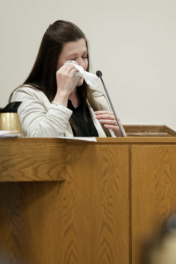 Alexis Somers wipes tears from her eyes while testifying at the trial of her father Martin MacNeill at the Fourth District Court in Provo Wednesday, Oct. 30, 2013. Martin MacNeill is charged with murder for allegedly killing his wife Michele MacNeill in 2007. Photo: Mark Johnston, AP / Pool, Daily Herald