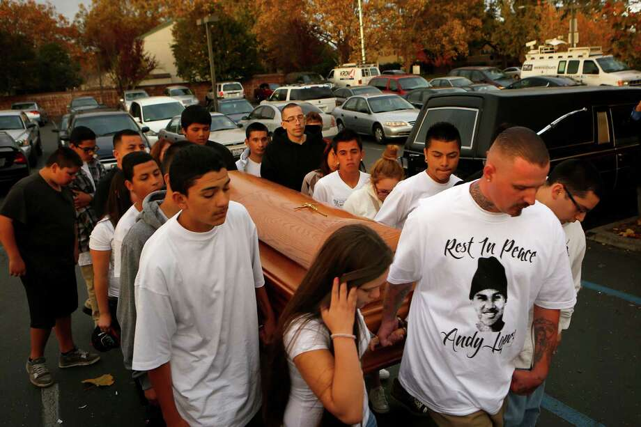 Friends of Andy Lopez carry his coffin into Resurrection Parish during his funeral ceremony in Santa Rosa, Calif., on Tuesday, Oct. 29, 2013. Lopez was shot by a Sonoma County deputy on Oct. 22. Authorities say the deputy mistook a pellet gun Lopez was carrying for an assault rifle. Photo: Conner Jay, AP / The Press Democrat