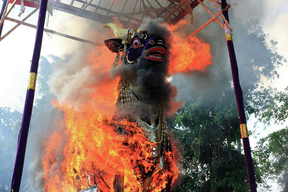 A giant sarcophagus in the form of a bull which contains the body of Tjokorda Istri Sri Tjandrawati is in flame during a cremation ceremony of a descendant of the Ubud Royal family in Bali, Indonesia, Friday, Nov. 1, 2013. Photo: Firdia Lisnawati, AP / AP
