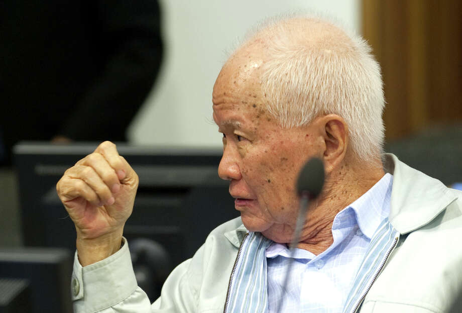 In this photo released by the Extraordinary Chambers in the Courts of Cambodia, Khieu Samphan, former Khmer Rouge head of state, gestures before his final statements at the U.N.-backed war crimes tribunal in Phnom Penh, Cambodia, Thursday, Oct. 31, 2013.  Along with former Khmer Rouge leader Nuon Chea, the U.N.-backed tribunal has also charged 82-year-old Khieu Samphan, with genocide and crimes against humanity, including torture, enslavement and murder, for their roles in the radical communist regime nearly 40 years ago. Photo: Mark Peters, AP / AP2013