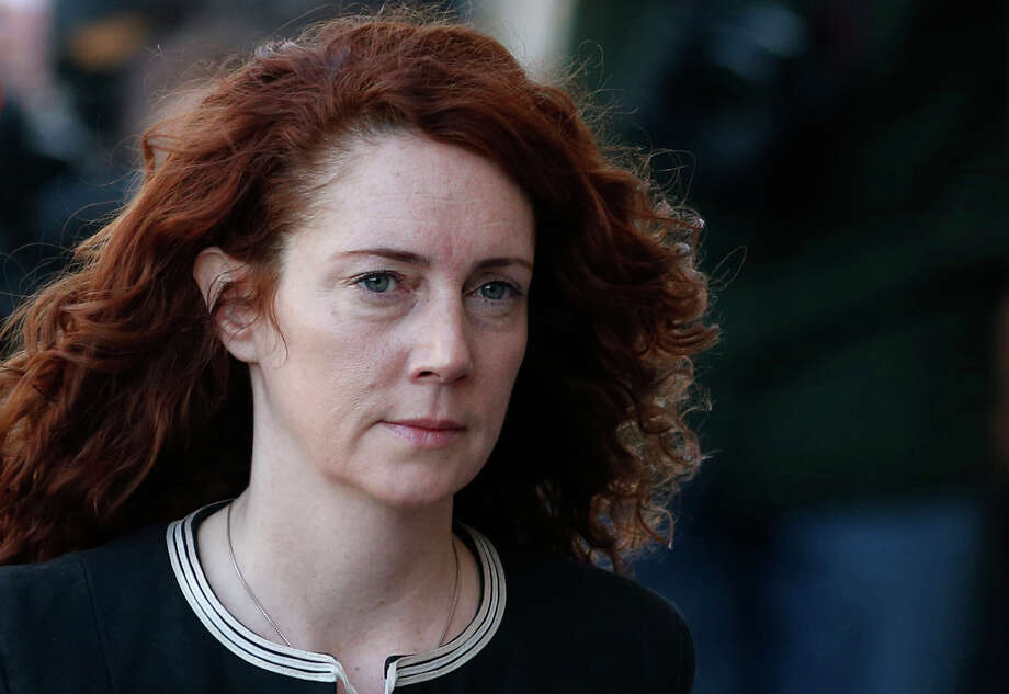 Former News of the World editor Rebekah Brooks arrives at Central Criminal Court in London, Tuesday, Oct. 29, 2013. Once one of the most powerful people in the British media, Brooks, a senior executive for media mogul Rupert Murdoch and associate of Prime Minister David Cameron, is accused on charges of hacking phones and bribing officials while at the now-shuttered Murdoch tabloid. Photo: Lefteris Pitarakis, AP / AP