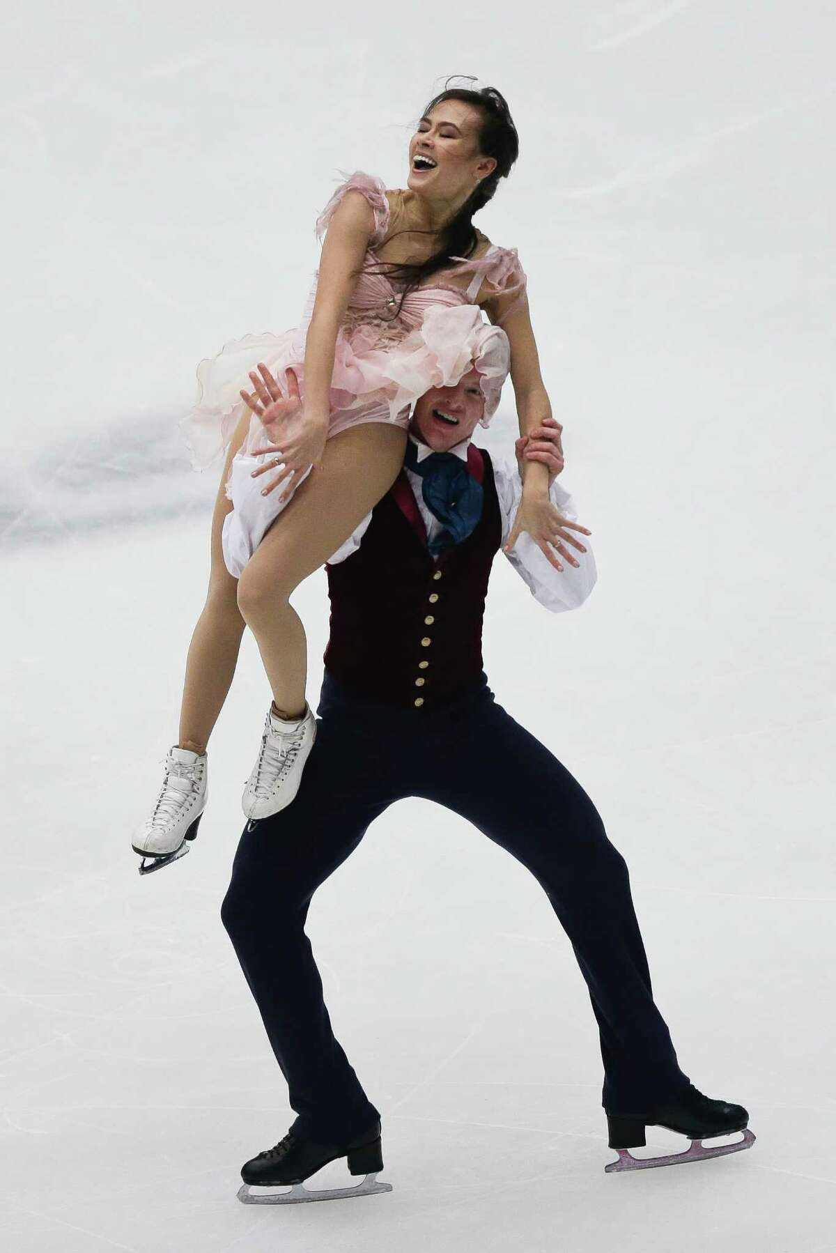 Madison Chock and Evan Bates, of United States, perform in the ice dance event at the Cup of China ISU 2013 Grand Prix of Figure Skating in Beijing, Saturday, Nov. 2, 2013.