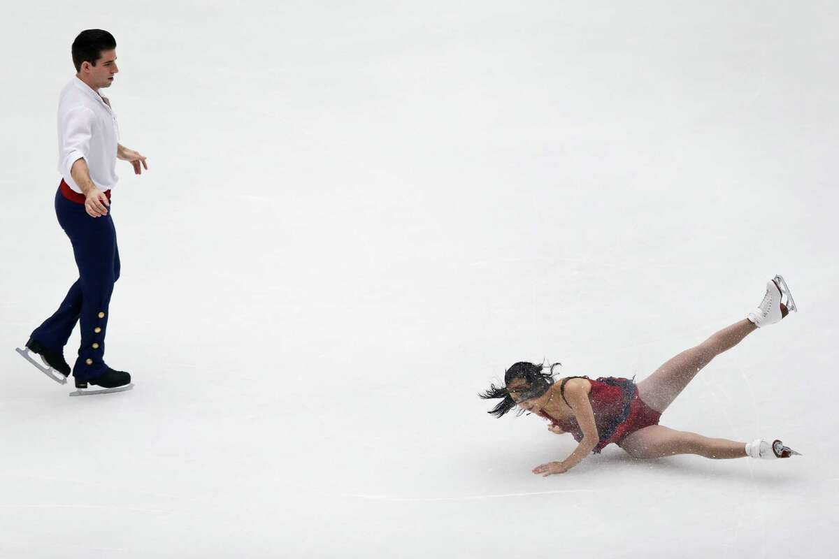 America's Filicia Zhang falls on the ice as she performs with partner Nathan Bartholomay in the pairs free skating event at the Cup of China ISU 2013 Grand Prix of Figure Skating in Beijing, Saturday, Nov. 2, 2013.Story: Russian teen wins Cup of China figure skating event