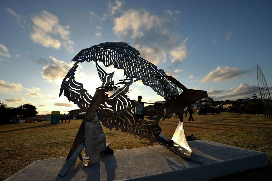 A visitor looks at a sculpture, which is part of the Sculpture by the Sea exhibition which runs along the Bondi to Tamarama coastal walk in Sydney, on October 31, 2013. The world's largest annual free-to-the-public outdoor sculpture exhibition runs 24 October - 10 November 2013 and features over 100 sculptures by artists from Australia and around the world. AFP PHOTO / Saeed Khan  Photo: SAEED KHAN, Getty Images / 2013 AFP