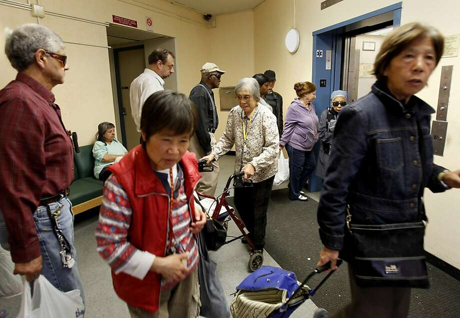 With a broken elevator at 330 Clementina Tower, the elevator lobby area is often crowded with long waits Wednesday October 9, 2013 in San Francisco, Calif. Mayor Ed Lee promised to make life better for residents of the city's public housing stock, but tenants at Clementina Towers often have problems with broken elevators and filth. Photo: Brant Ward, The Chronicle