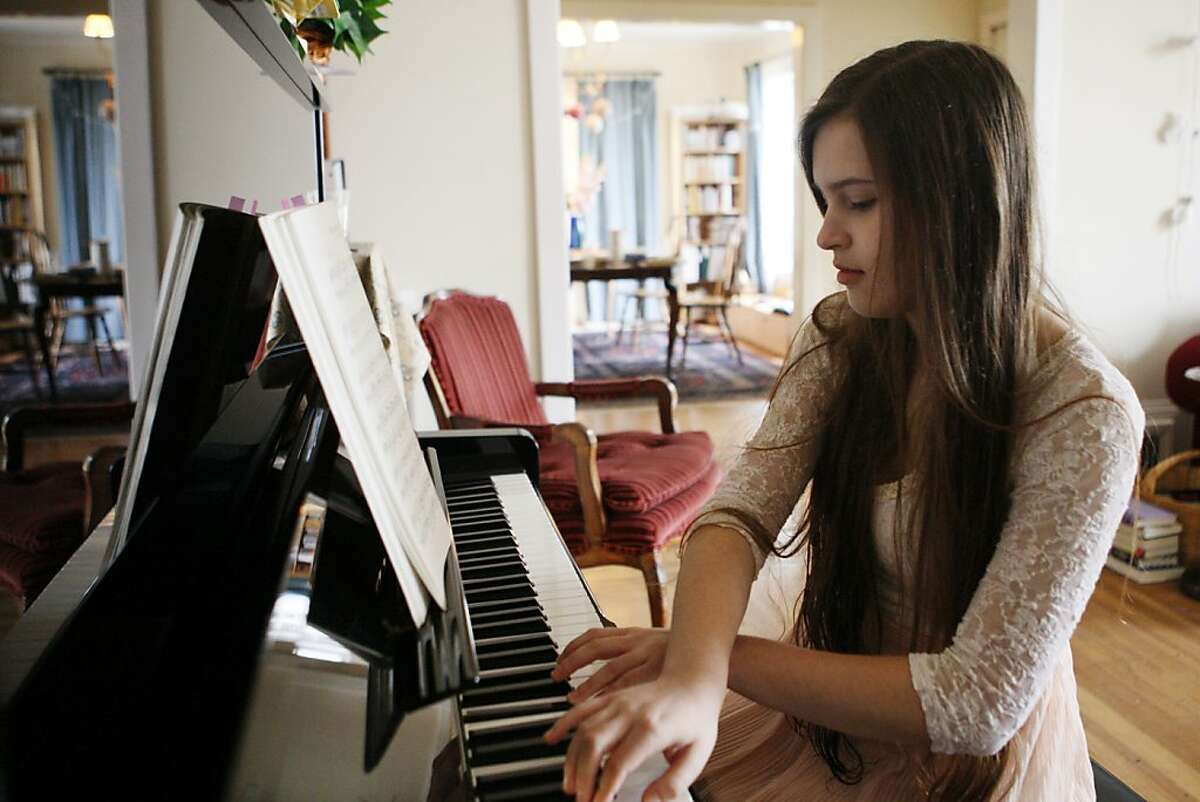 Rachael Cornejo practices at the piano at her home in Berkeley, Calif. on Saturday, Nov. 2, 2013.