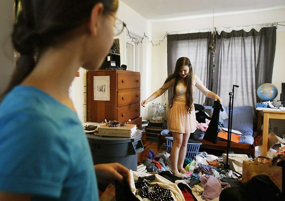 Rachael Cornejo looks in her room for clothes to lend to her sister Hannah at their home in Berkeley, Calif. on Saturday, Nov. 2, 2013.