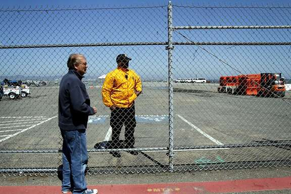 Lawrence Stokus stops to talk to a security guard at Piers 30-32 about the proposed Warriors arena in San Francisco, Calif. Wednesday, May 30, 2012.  Stokus lives in the neighborhood and would rather see the land be used as a park.