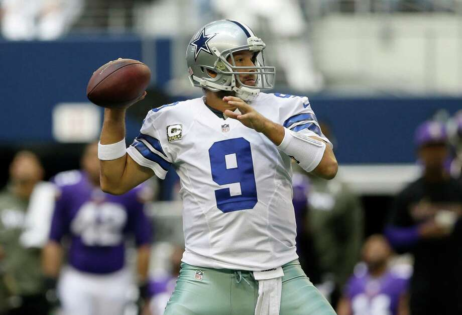 Dallas Cowboys quarterback Tony Romo (9) throws a pass in the first  half of an NFL football game against the Minnesota Vikings Sunday, Nov. 3, 2013, in Arlington, Texas. (AP Photo/Tim Sharp) Photo: Tim Sharp, Associated Press / FR62992 AP