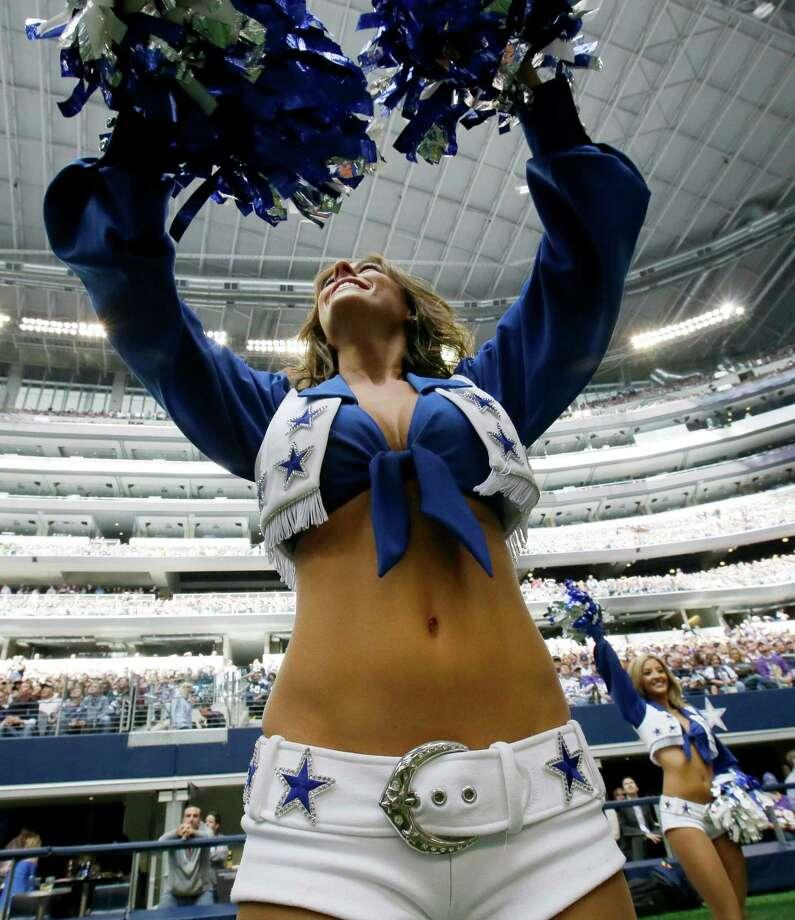 A Dallas Cowboys cheerleader performs during the first half of an NFL football game against the Minnesota Vikings Sunday, Nov. 3, 2013, in Arlington, Texas. (AP Photo/Nam Y. Huh) Photo: Nam Y. Huh, Associated Press / AP