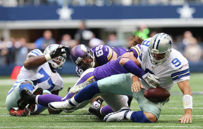 Dallas Cowboys' quarterback Tony Romo is sacked by Minnesota Vikings' defensive end Brian Robison du