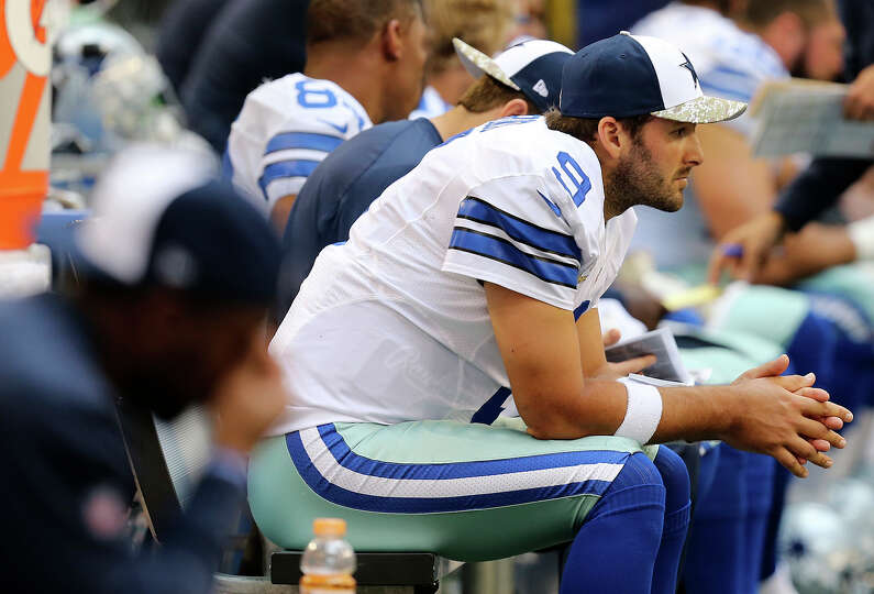 Dallas Cowboys quarterback Tony Romo sits on the bench during the first half against the Minnesota V