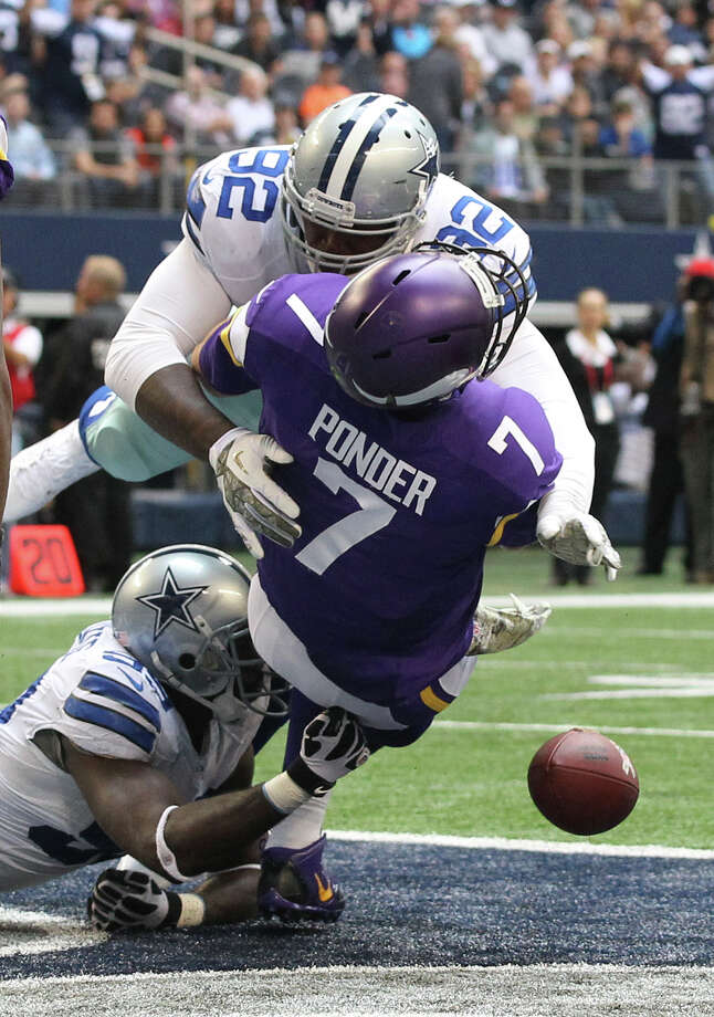 Minnesota Vikings' quarterback Christian Ponder fumbles the ball as his is sacked in the endzone by Dallas Cowboys' defensive ends George Selvie, bottom, and Jarius Wynn during the second half at AT&T Stadium, Sunday, Nov. 3, 2013. Cowboys' Nick Hayden recovered for a touchdown. The Cowboys won, 27-23. Photo: Jerry Lara, San Antonio Express-News / ©2013 San Antonio Express-News