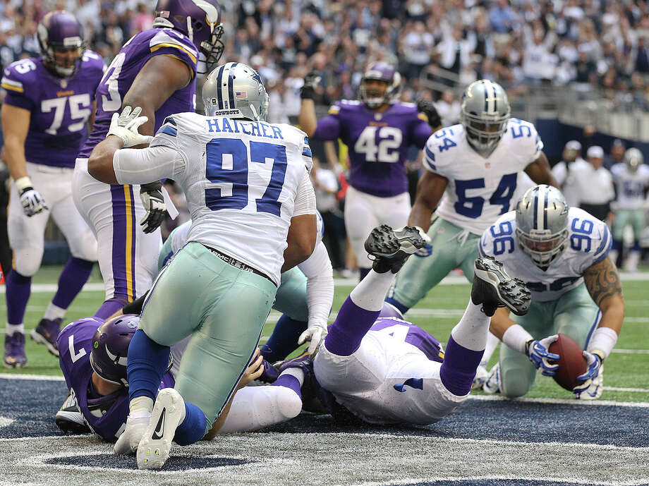 Dallas Cowboys' Nick Hayden, (96), recovers a fumble after Minnesota Vikings' quarterback Christian Ponder is sacked in the end zone during the second half at AT&T Stadium, Sunday, Nov. 3, 2013. The Cowboys won, 27-23. Photo: Jerry Lara, San Antonio Express-News / ©2013 San Antonio Express-News