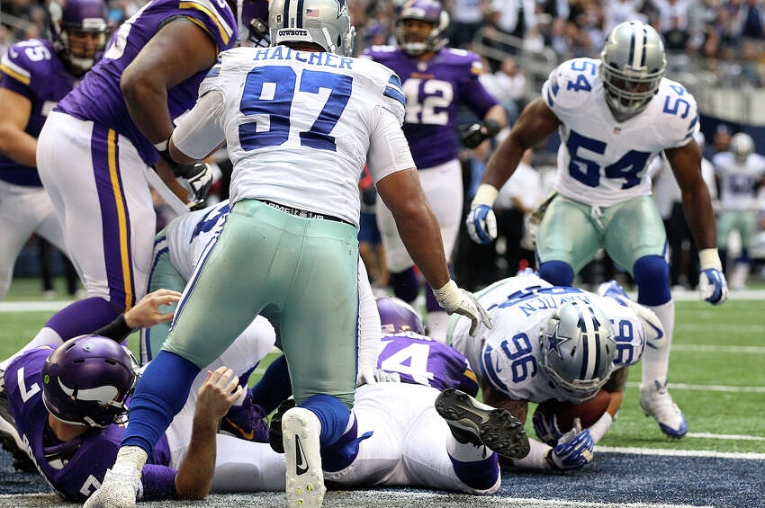 Dallas Cowboys' Nick Hayden, (96), recovers a fumble after Minnesota Vikings' quarterback Christian Ponder is sacked in the end zone during the second half at AT&T Stadium, Sunday, Nov. 3, 2013. The Cowboys won, 27-23.