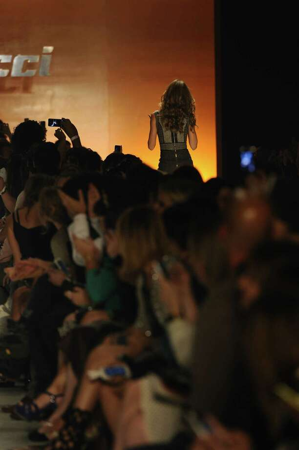 Gisele Bundchen walks the runway during Colcci show at Sao Paulo Fashion Week Winter 2014 on October 31, 2013 in Sao Paulo, Brazil. Photo: Fernanda Calfat, Getty Images / 2013 Fernanda Calfat