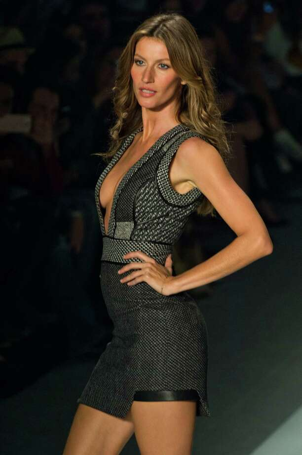 Brazilian supermodel Gisele Bundchen presents a creation by Colcci during the 2014 Winter collections of the Sao Paulo Fashion Week in Sao Paulo, Brazil, on October 31, 2013. AFP PHOTO / Nelson ALMEIDA Photo: NELSON ALMEIDA, Getty Images / 2013 AFP