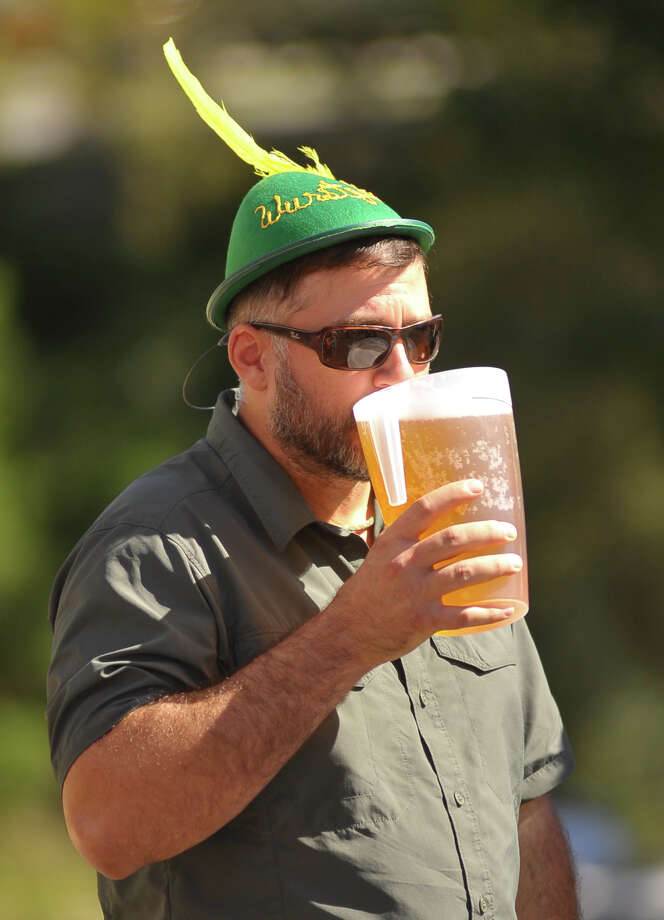 Michael Mylonas enjoys his beer at Wurstfest in New Braunfels on Sunday afternoon, Nov. 3, 2013. Photo: Robin Jerstad