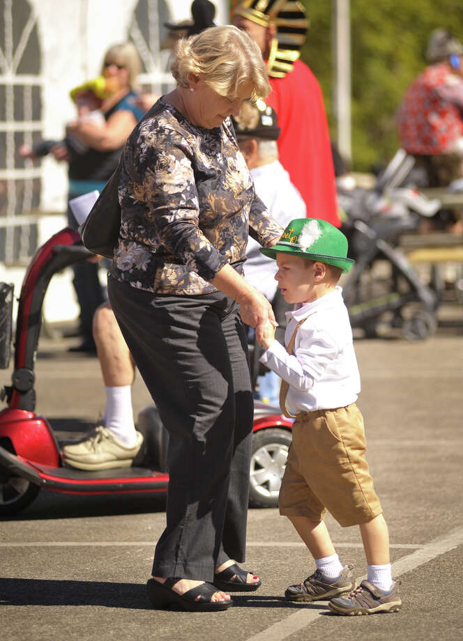 Donna Ewald dances with her 2-year-old grandson Jackson Ewald during Wurstfest on Sunday, Nov. 3, 2013, in New Braunfels. Photo: Robin Jerstad