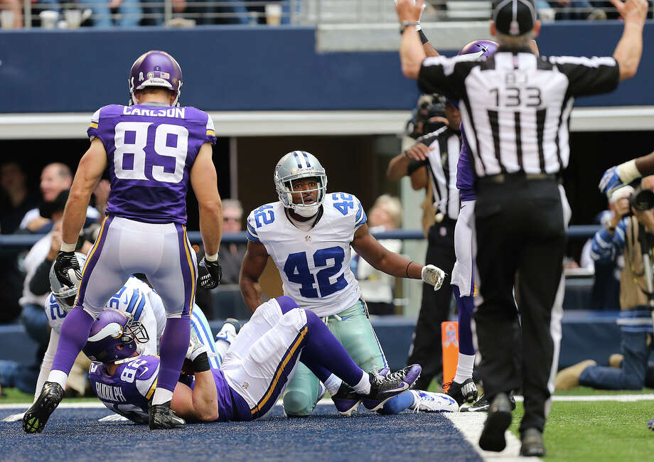 Dallas Cowboys' safety Barry Church watches for the call after Minnesota Vikings' tight end Kyle Rudolph, (82), scores during the second half at AT&T Stadium, Sunday, Nov. 3, 2013. The Cowboys won, 27-23. Photo: Jerry Lara, San Antonio Express-News / ©2013 San Antonio Express-News