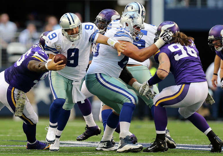 Dallas Cowboys' quarterback Tony Romo slips out of the pocket and scrambles for a first down during
