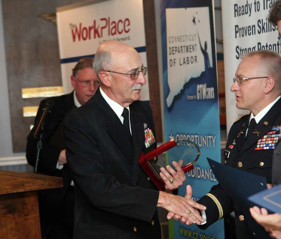 "Veteran Richard Iannucci, of Stratford, receives a  ""Service to Country and Community award"" at a luncheon"" sponsored by the Workplace and CT Department of Labor's Office of Veterans at Port 5 in Bridgeport on Sunday, Nov. 3, 2013. Photo: BK Angeletti, B.K. Angeletti / Connecticut Post freelance B.K. Angeletti"