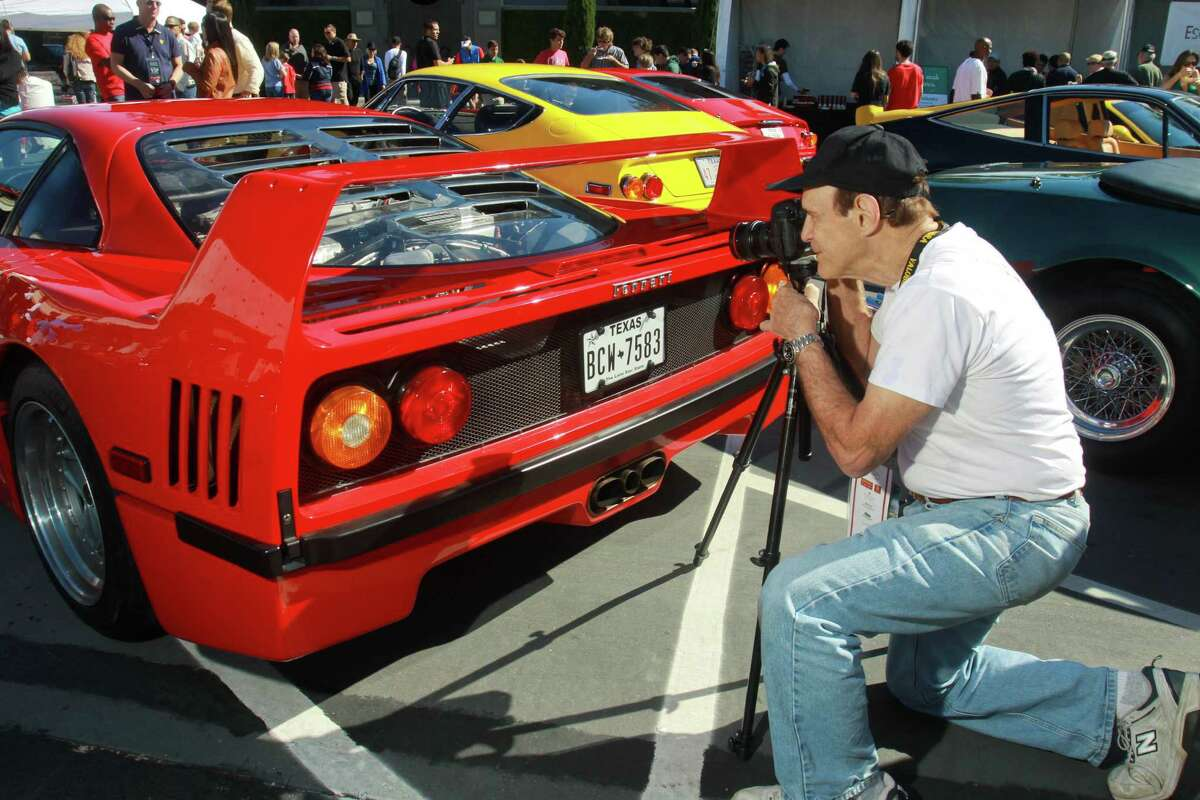 """(For the Chronicle/Gary Fountain, November 3, 2013) Andy Solomon photographing detail on a Ferrari F40 at the Highland Village Ferrari Festival. The book he authored, """"Autochrome,"""" is a book of his photographs and is a fine art approach to classic cars."""