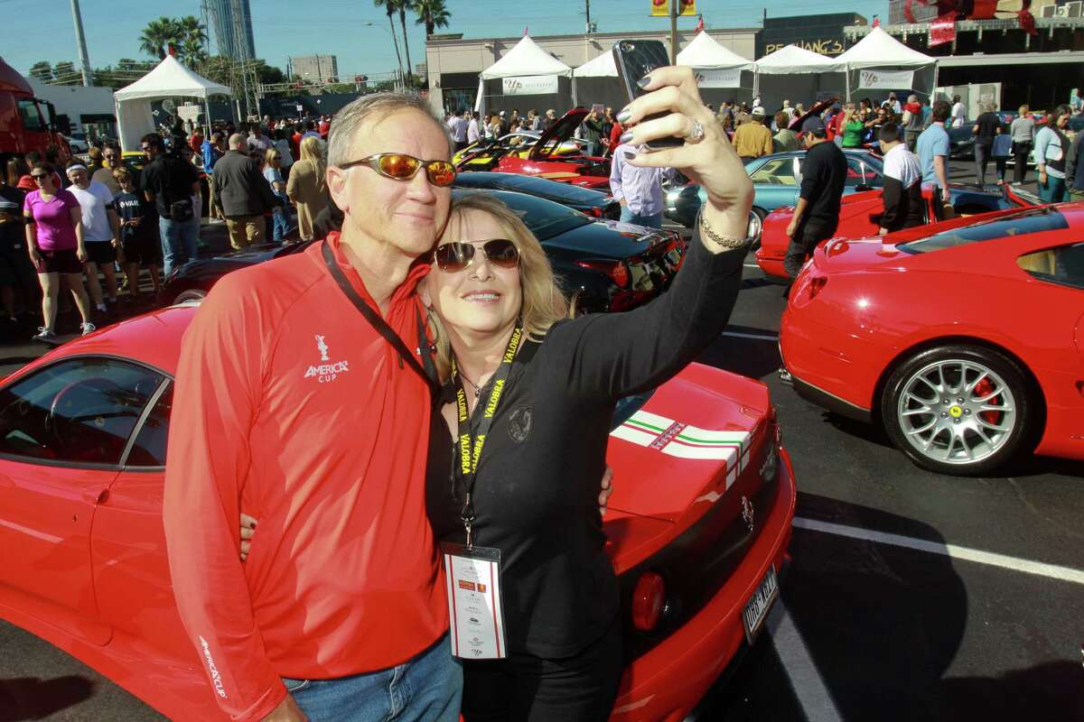 (For the Chronicle/Gary Fountain, November 3, 2013) Mike and Ronna Hardage doing a self-portrait in front of their Ferrari Challenge Stradale at the Highland Village Ferrari Festival.