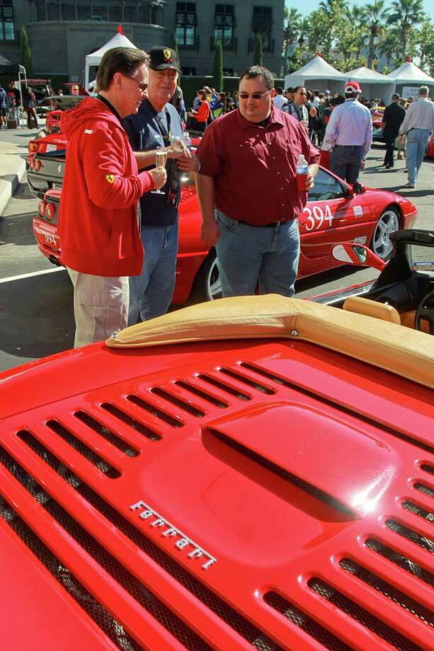 (For the Chronicle/Gary Fountain, November 3, 2013) Mike McNamee, from left, David LaFargue and James Jones at the Highland Village Ferrari Festival. In the foreground is a Ferrari 355 Spider. Mike is president of the Houston Chapter of the Ferrari Club of America. Photo: Gary Fountain, For The Chronicle / Copyright 2013 Gary Fountain.