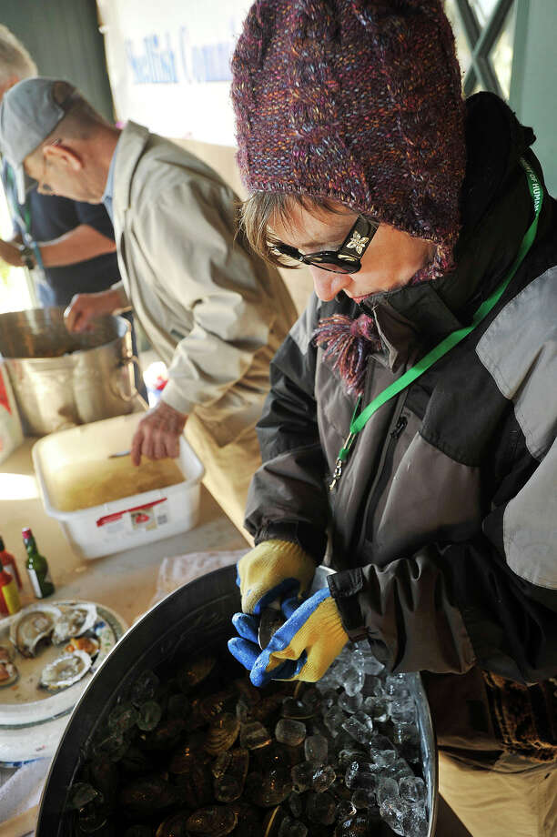 Gina Gould, with the Shellfish Commission, shucks clams during Oyster Fishing Family Day at the Seaside Center at Greenwich Point Park in Greenwich, Conn., on Sunday, Nov. 3, 2013. Photo: Jason Rearick / Stamford Advocate