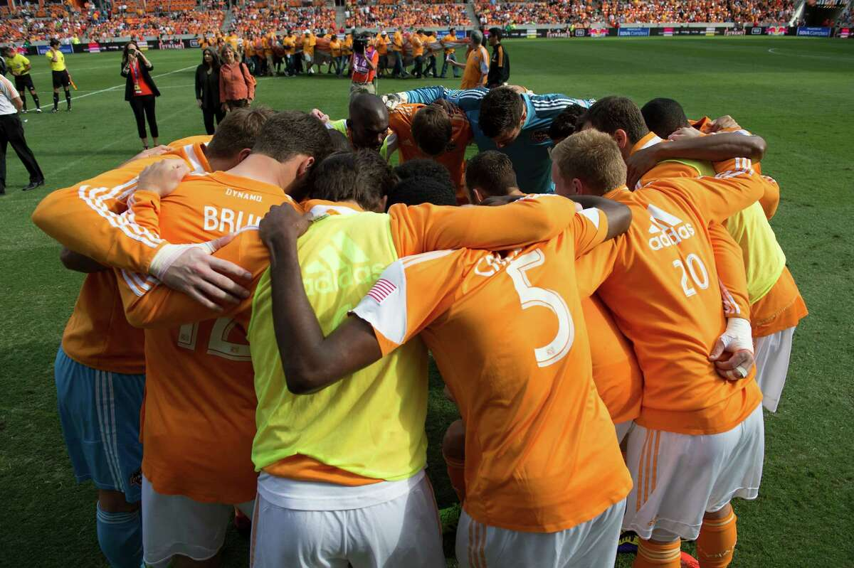 Houston Dynamo players huddle before facing the New York Red Bulls in an MLS soccer Eastern Conference Semifinal playoff match on Sunday, Nov. 3, 2013, at BBVA Compass Stadium in Houston.