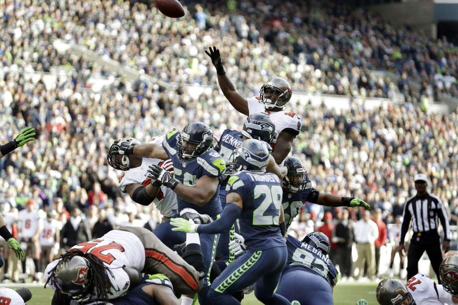 Tampa Bay Buccaneers running back Mike James, top, passes over Seattle Seahawks defensive players for a touchdown to Buccaneers' Tom Crabtree in the first half of an NFL football game Sunday, Nov. 3, 2013, in Seattle. (AP Photo/Elaine Thompson) Photo: AP