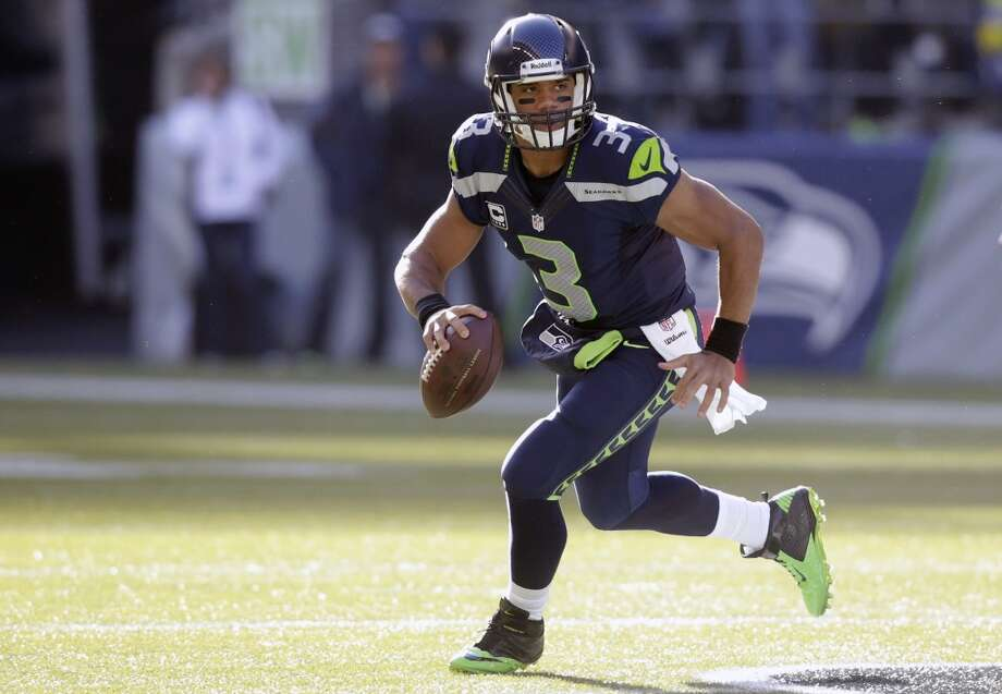 Seattle Seahawks quarterback Russell Wilson scrambles in the first half of an NFL football game against the Tampa Bay Buccaneers, Sunday, Nov. 3, 2013, in Seattle. (AP Photo/Stephen Brashear) Photo: AP