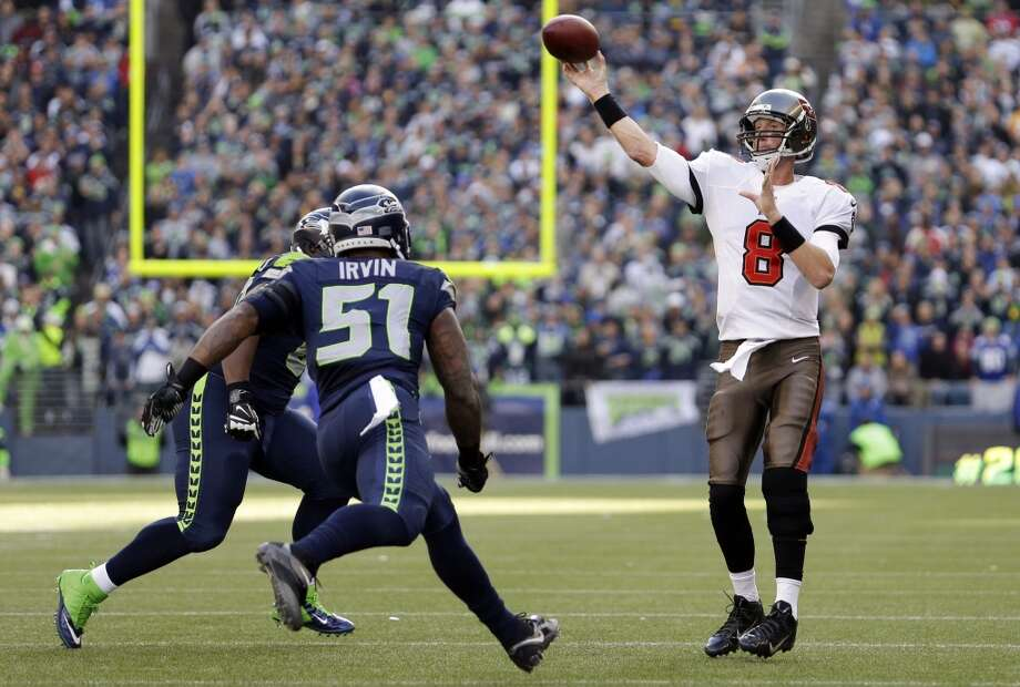 Tampa Bay Buccaneers quarterback Mike Glennon (8) makes a touchdown pass to Tampa Bay Buccaneers' Timothy Wright as Seattle Seahawks' Bruce Irvin (51) and Clinton McDonald close in during the first half of an NFL football game Sunday, Nov. 3, 2013, in Seattle. (AP Photo/Elaine Thompson) Photo: AP