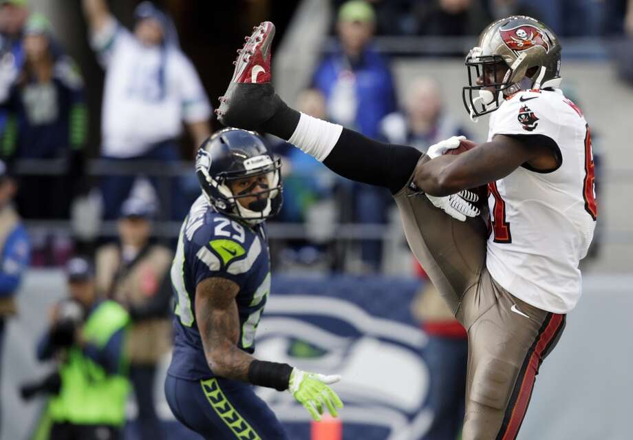 Tampa Bay Buccaneers tight end Timothy Wright, right, comes down with a catch for a touchdown as Seattle Seahawks free safety Earl Thomas stands at left, in the first half of an NFL football game Sunday, Nov. 3, 2013, in Seattle. (AP Photo/Stephen Brashear) Photo: AP