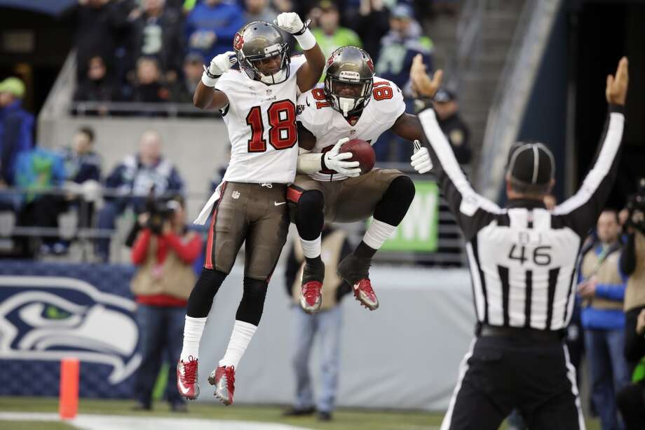 Tampa Bay Buccaneers' tight end Timothy Wright, right, celebrates with wide receiver Skye Dawson (18) after Wright caught a pass for a touchdown against the Seattle Seahawks in the first half of an NFL football game Sunday, Nov. 3, 2013, in Seattle. (AP Photo/Stephen Brashear) Photo: ASSOCIATED PRESS