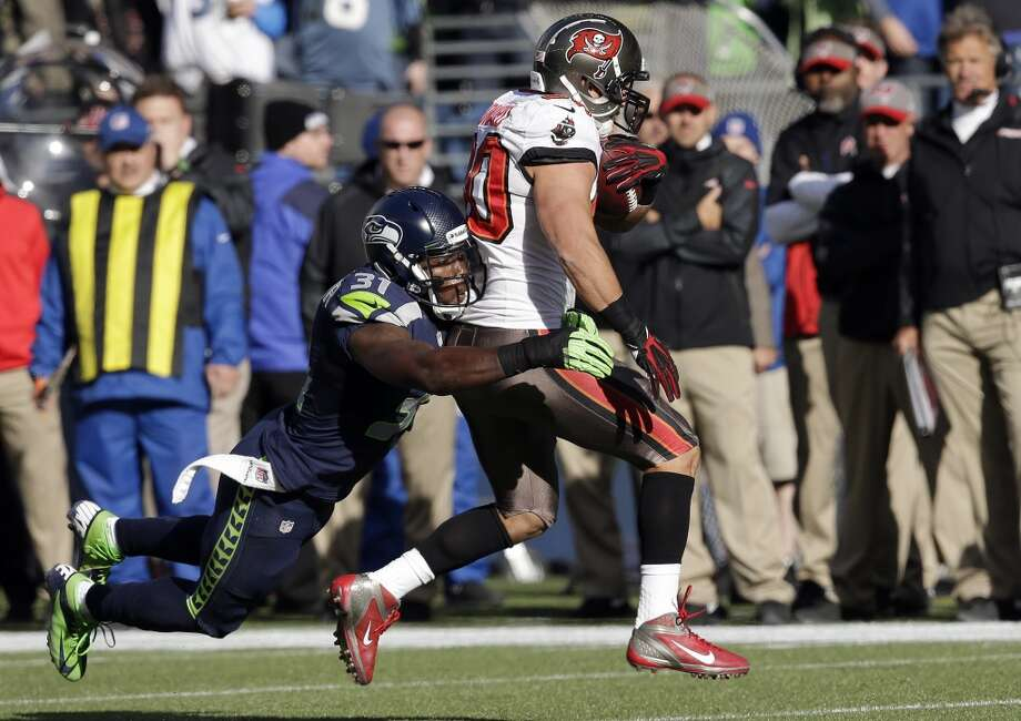 Tampa Bay Buccaneers' Brian Leonard, right, is tackled by Seattle Seahawks strong safety Kam Chancellor in the first half of an NFL football game Sunday, Nov. 3, 2013, in Seattle. (AP Photo/Elaine Thompson) Photo: ASSOCIATED PRESS