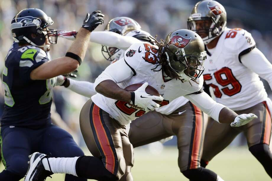 Tampa Bay Buccaneers strong safety Mark Barron (23) runs the ball after intercepting a pass from Seattle Seahawks quarterback Russell Wilson in the first half of an NFL football game Sunday, Nov. 3, 2013, in Seattle. (AP Photo/Elaine Thompson) Photo: AP