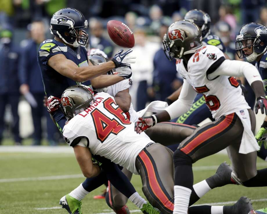 Seattle Seahawks kick returner Jermaine Kearse, upper left, fumbles the ball as he is tackled by Tampa Bay Buccaneers' Spencer Larsen in the first half of an NFL football game, Sunday, Nov. 3, 2013, in Seattle. Tampa Bay kicker Michael Koenen recovered the fumble. (AP Photo/Stephen Brashear) Photo: AP