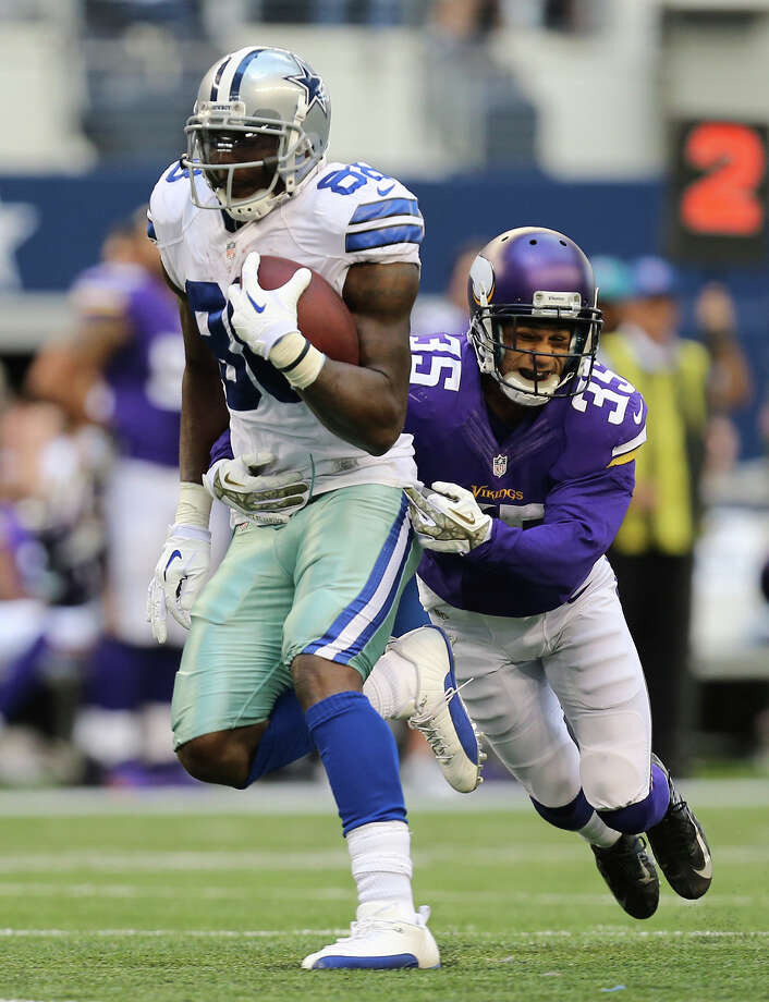 Dallas Cowboys' wide receiver Dez Bryant is tackled by Minnesota Vikings' cornerback Marcu Sherels during the second half at AT&T Stadium, Sunday, Nov. 3, 2013. The Cowboys won, 27-23. Photo: Jerry Lara, San Antonio Express-News / ©2013 San Antonio Express-News