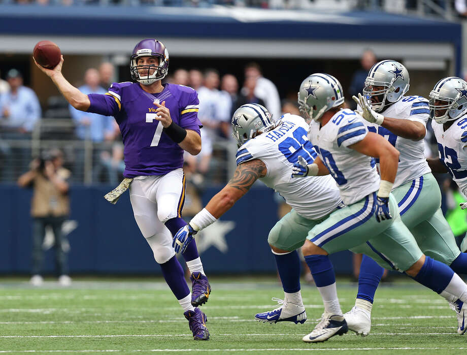 Under pressure from the Dallas Cowboys defensive line, Minnesota Vikings quarterback Christian Ponder passes during the first half at AT&T Stadium, Sunday, Nov. 3, 3013. Photo: Jerry Lara, San Antonio Express-News / ©2013 San Antonio Express-News