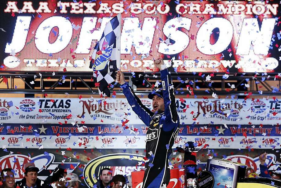 Jimmie Johnson celebrates in Victory Lane after the Texas 500 at Texas Motor Speedway. Photo: Chris Graythen, Getty Images For Texas Motor Spe