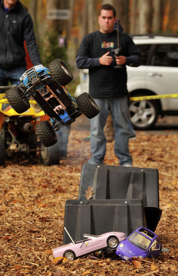 Steve Navard pilots a radio controlled truck off a ramp during the sixth annual Stamford Charity Chili Cookoff at the Stamford Museum and Nature Center in Stamford, Conn., on Sunday, Nov. 3, 2013. Photo: Jason Rearick / Stamford Advocate