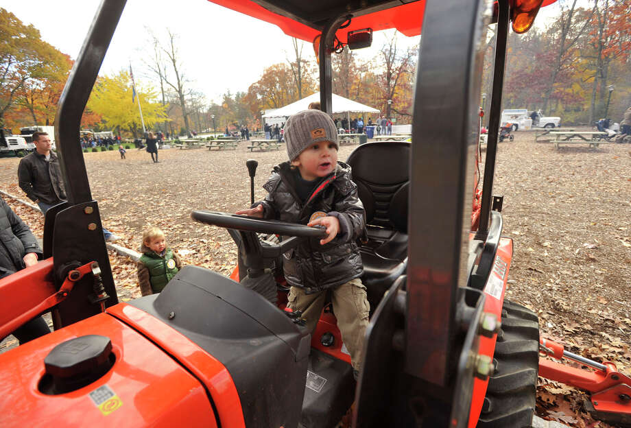 David Dine, 3, plays on a excavator during the sixth annual Stamford Charity Chili Cookoff at the Stamford Museum and Nature Center in Stamford, Conn., on Sunday, Nov. 3, 2013. Photo: Jason Rearick / Stamford Advocate